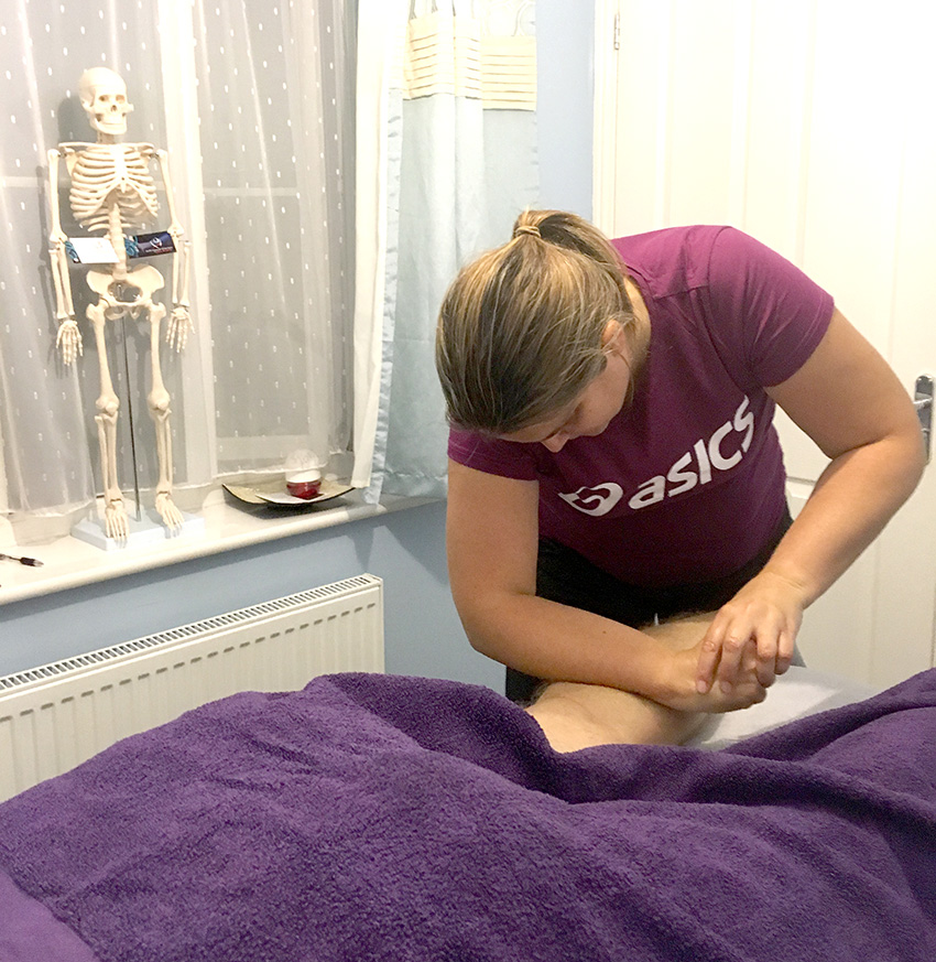 Jen Evans massaging the calf muscle